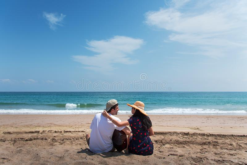Couple spending time on the beach with a guitar royalty free stock images