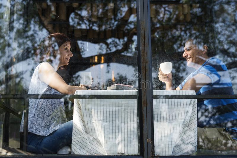 Couple spending time together having breakfast stock images
