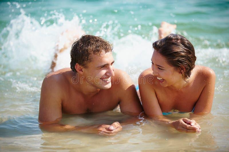 Couple splashing royalty free stock photo