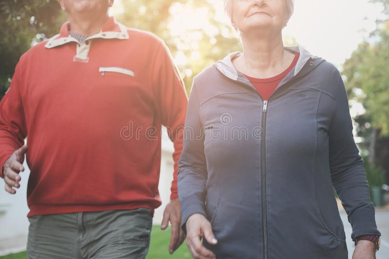 Couple in sports clothing having exercise in city park. C stock photos