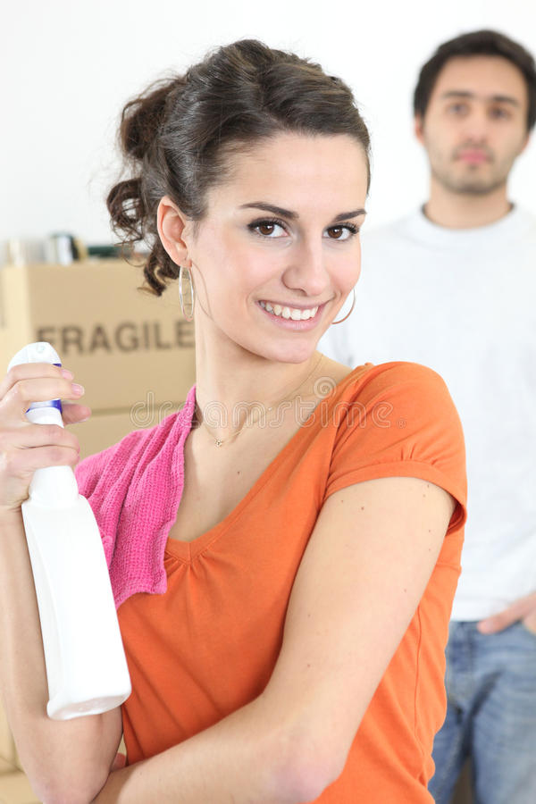 Couple spring cleaning. Before house move royalty free stock image