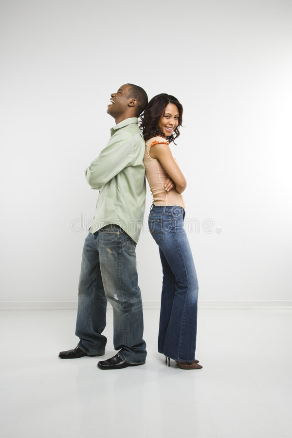 Couple standing back to back. royalty free stock photos