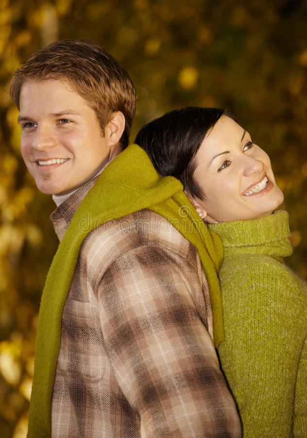 Couple Standing Back To Back In Park Royalty Free Stock Photos