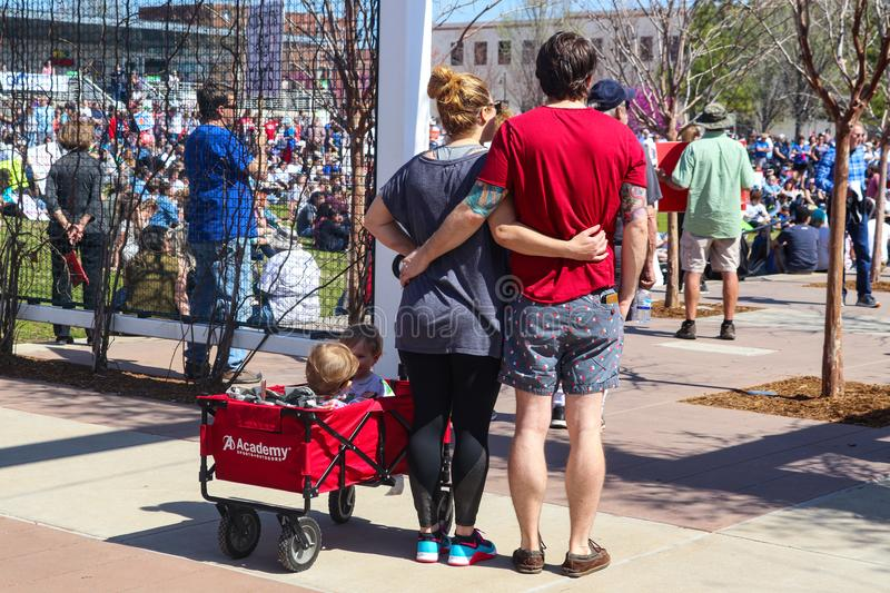 Couple standing back to camera with arms around one another and two children in wagon at March for Life protest in Tulsa Oklahoma royalty free stock photography