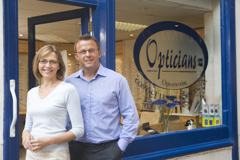 Download Couple Standing At Entrance Of Optometrists Stock Image - Image: 5929853