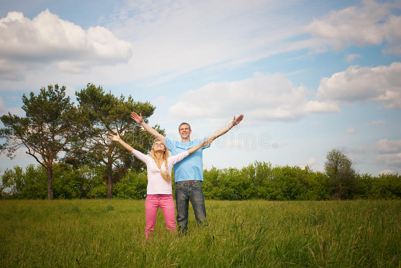 Download Couple standing on grass stock image. Image of love, girl - 13168641