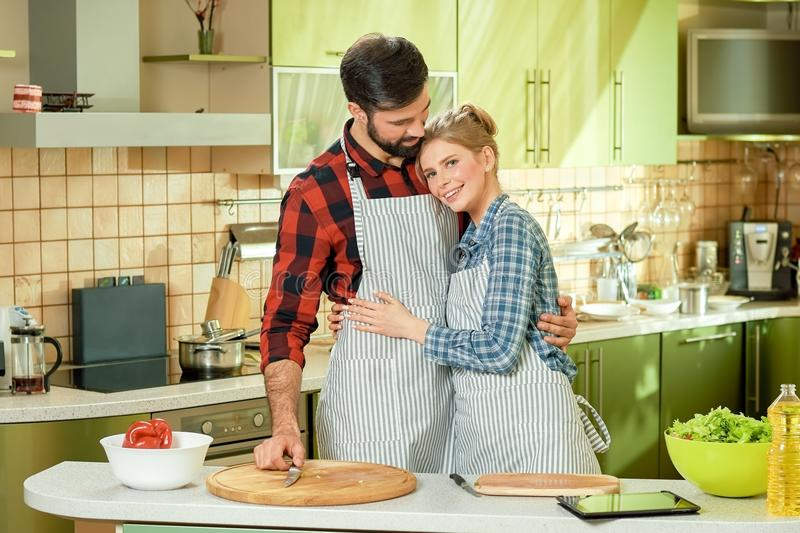 Couple standing in the kitchen. royalty free stock photos