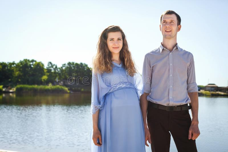 Couple standing by lake stock photography