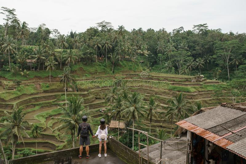 Couple standing near rice terraces in Bali Indonesia stock photography