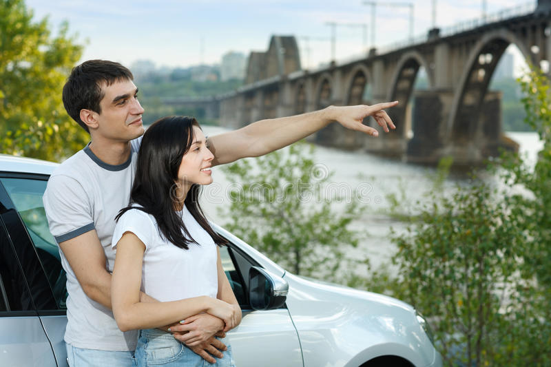 Download Couple Standing Outside Their Car In Embrace Stock Image - Image: 26312751