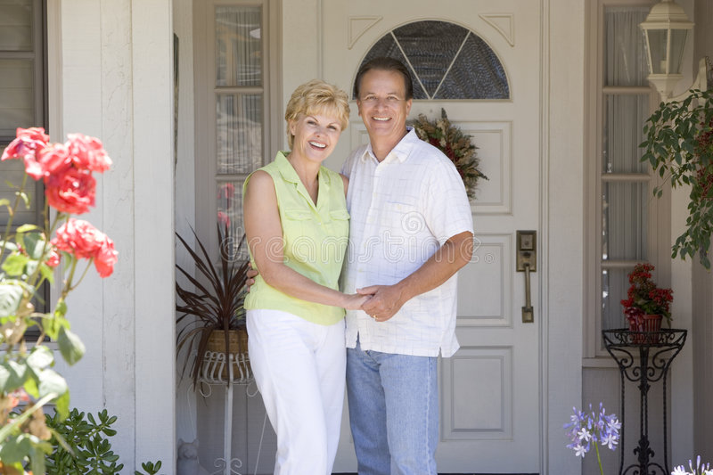 Couple Standing Outside Their House stock image