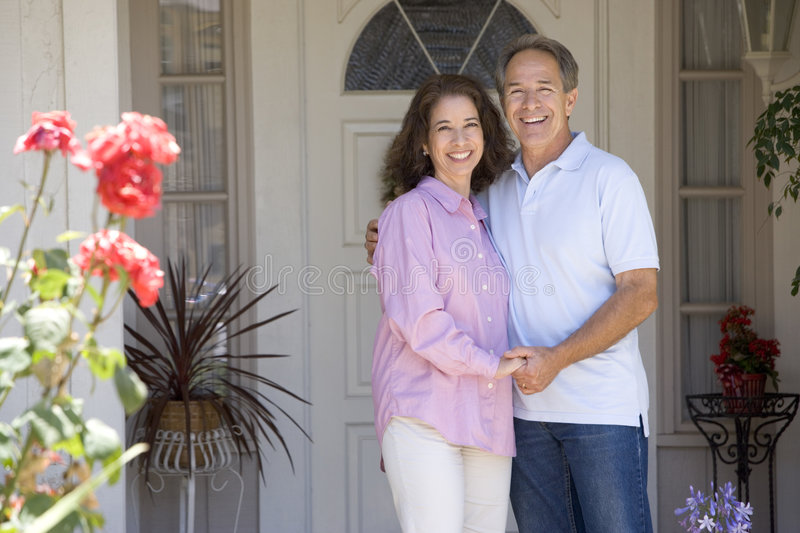 Couple Standing Outside Their House Stock Photography