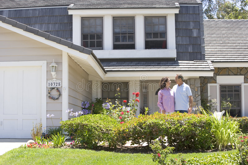 Download Couple Standing Outside Their House Stock Image - Image: 7876965
