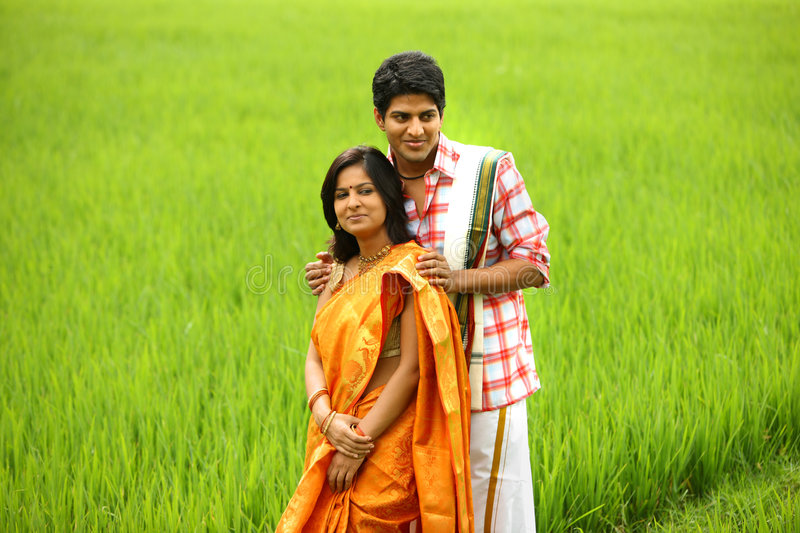 Couple standing in a paddy field stock image