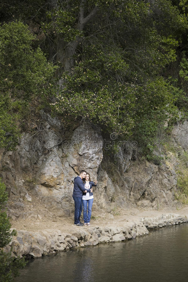 Download Couple Standing On Side Of Lake Stock Photo - Image: 11125328