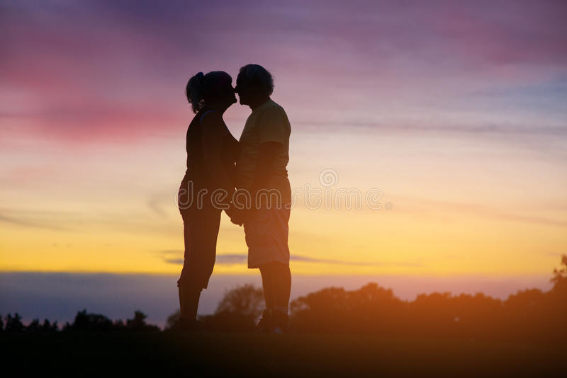 Couple standing on sky background. stock image