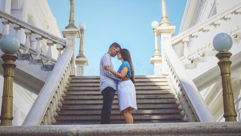 Couple Standing By The Stairs royalty free stock photography