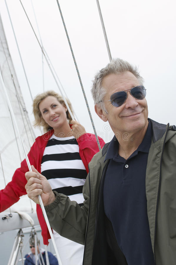 Couple On Standing Yacht stock photo