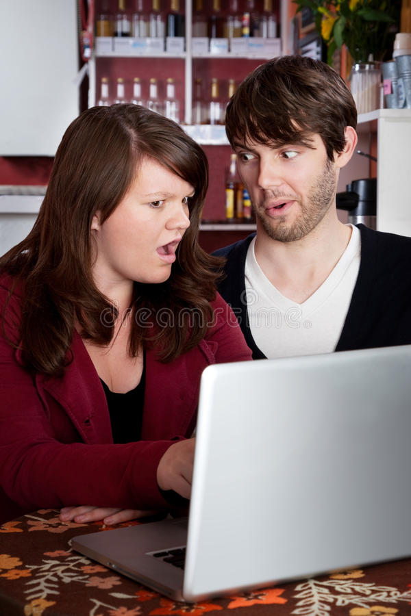 Download Couple Staring In Disbelief At A Computer Laptop Stock Image - Image: 15116775
