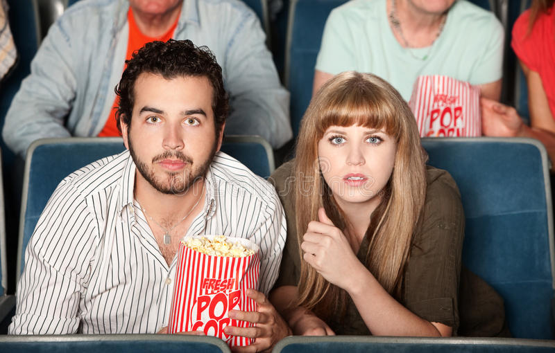Couple Staring in Theater stock photo