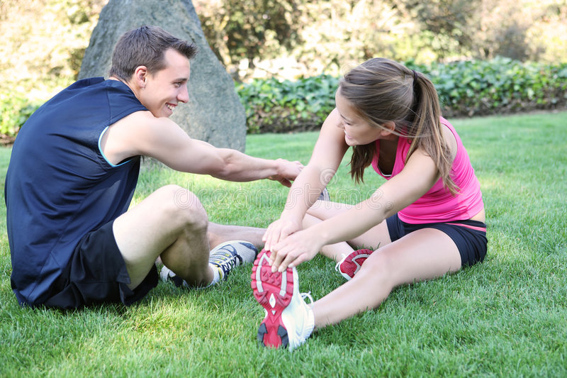 Couple Stretching in the Park stock image