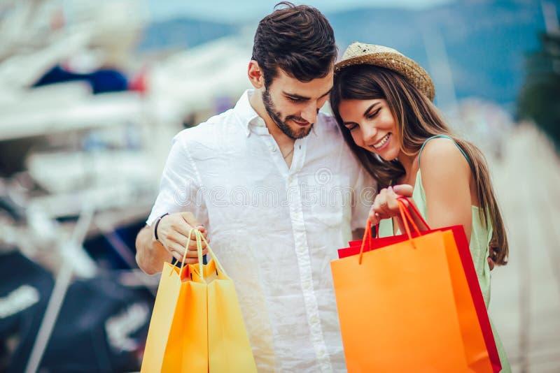 Couple on vacation enjoying travel and shopping royalty free stock photo