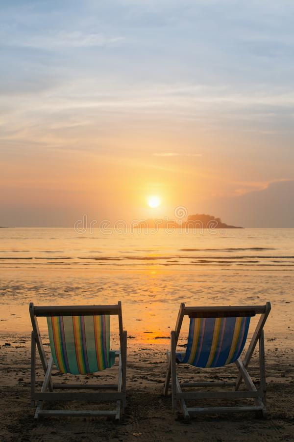 Couple of sun loungers on the beach. Couple of sun loungers on the beach during sunset stock images