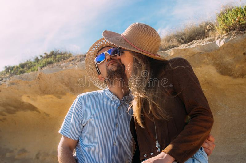 Couple in sunglasses embrace  in the day in the hills stock photos