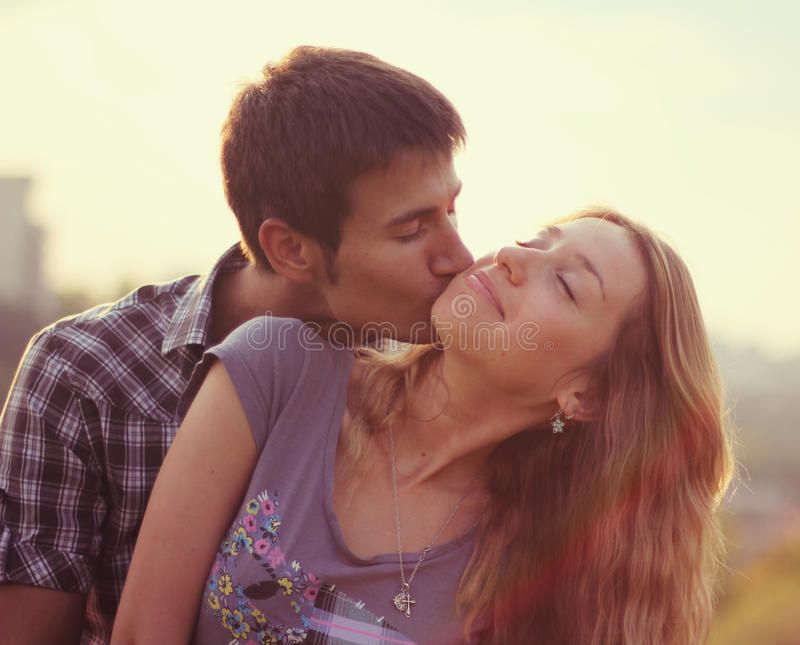 Download Couple at sunset stock image. Image of kiss, togetherness - 23615769