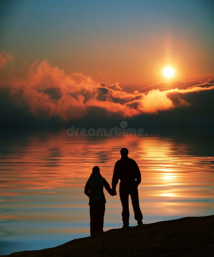 Couple on sunset stock photo