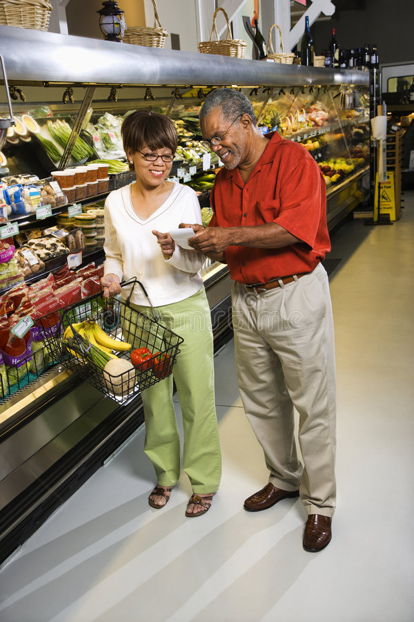 Download Couple in supermarket. stock image. Image of adult, high - 3470555
