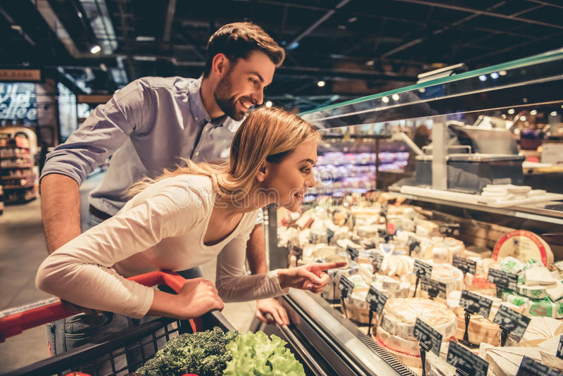 Couple at the supermarket royalty free stock photos