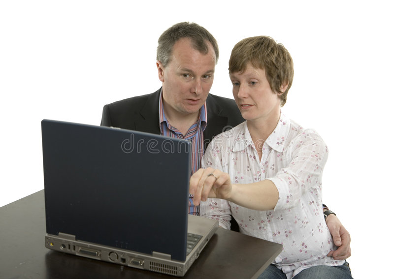 Couple surfing stock photography