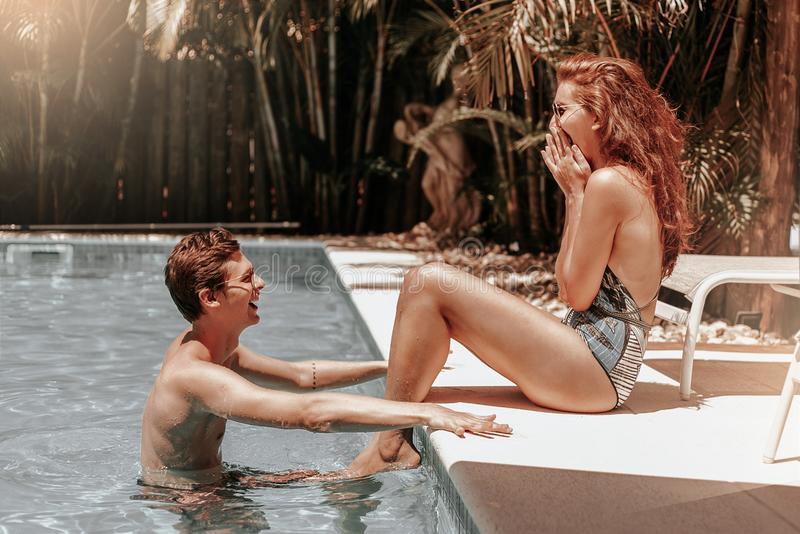 Couple at the Swimming Pool royalty free stock photo