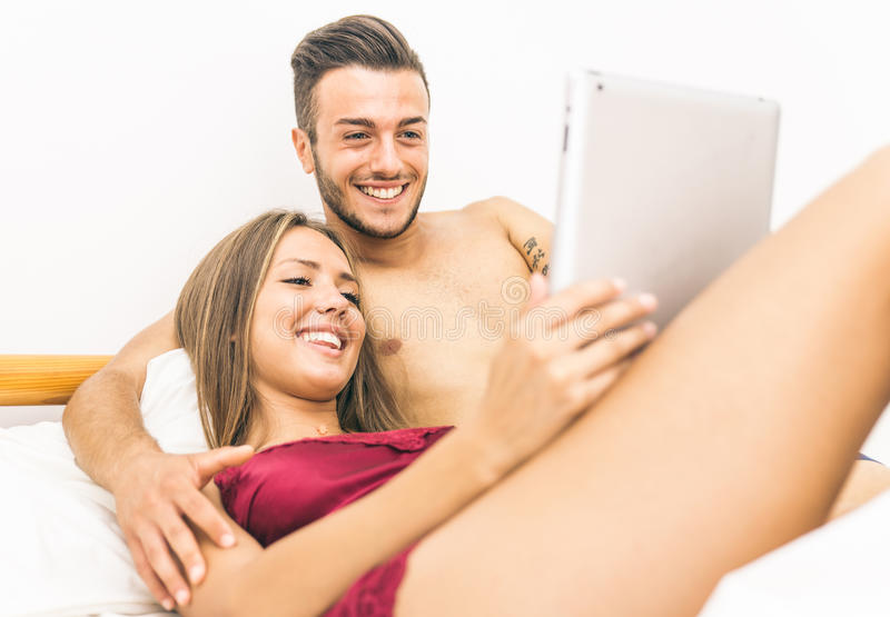 Couple with tablet in bed royalty free stock photo