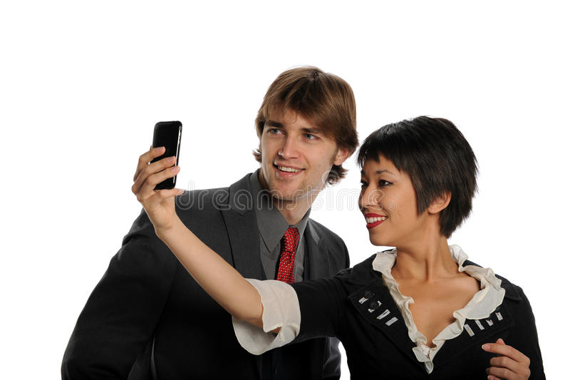 Couple taking photo with cell phone royalty free stock photo