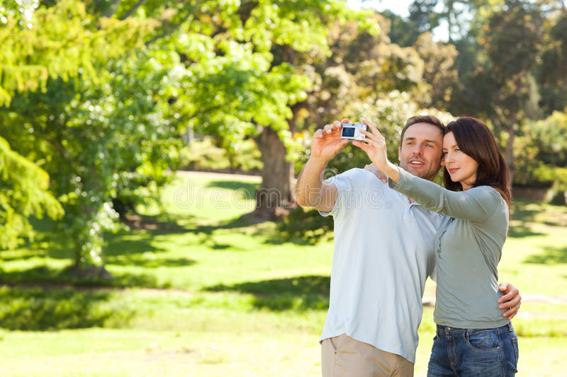 Download Couple Taking A Photo Of Themselves In The Park Stock Photo - Image: 18466820
