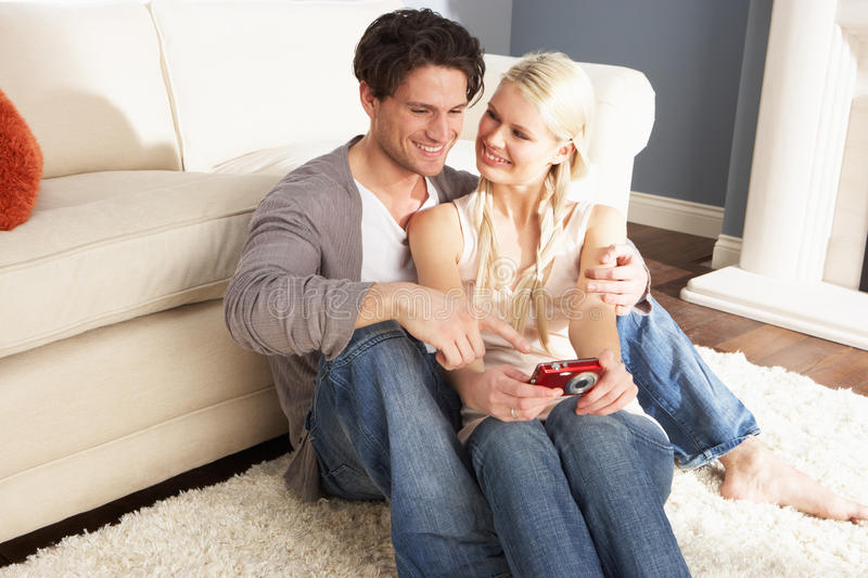 Couple Taking Photograph On Digital Camera At Home royalty free stock photos