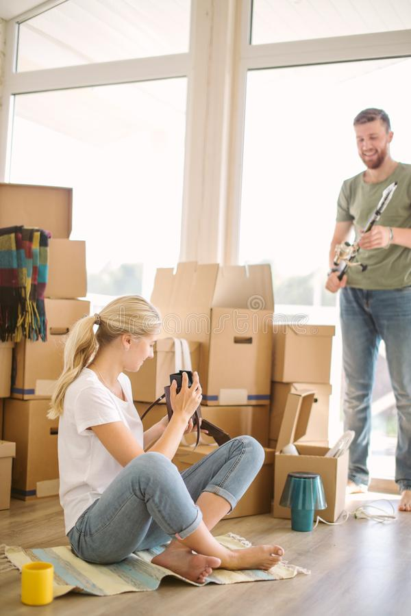 Couple Taking A Picture In New Home stock photos