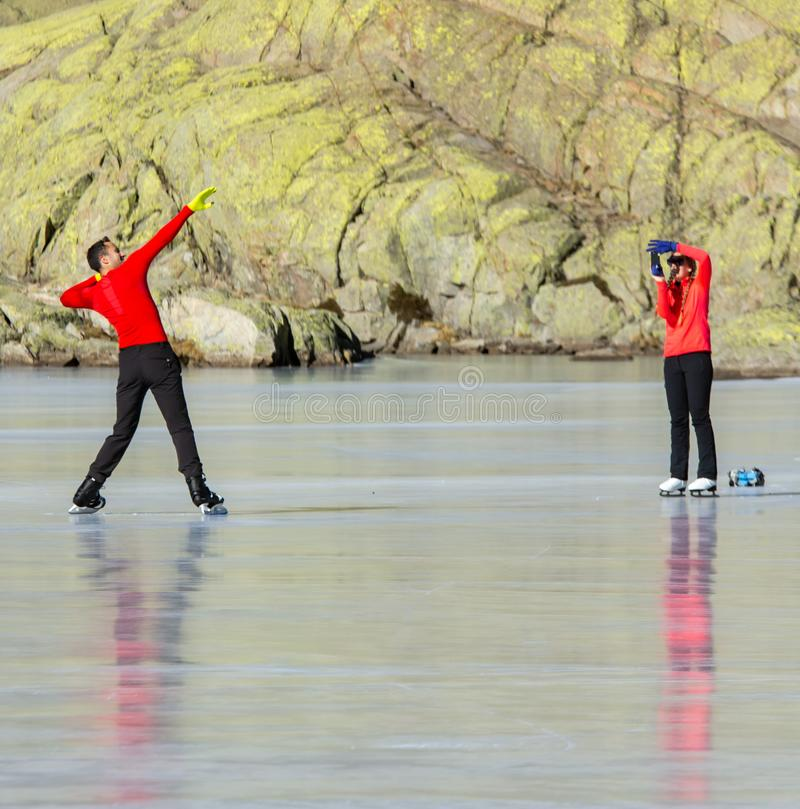 Gredos, Spain. 12-January-2019. Funny Couple taking pictures on a frozen lake during a sunny winter day stock images