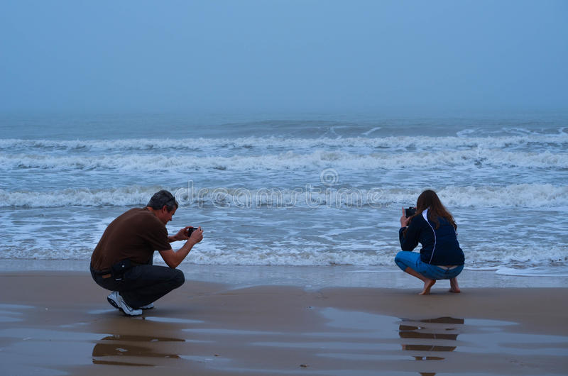 Download Couple Taking Pictures Of The Surf Stock Photo - Image of matagorda, pictures: 39508828