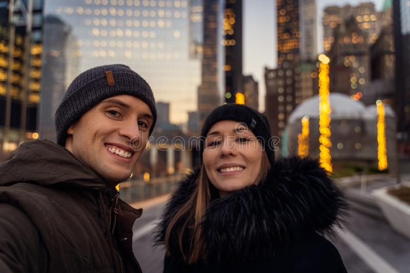 Couple taking a selfie in Manhattan new York during sunset stock photo