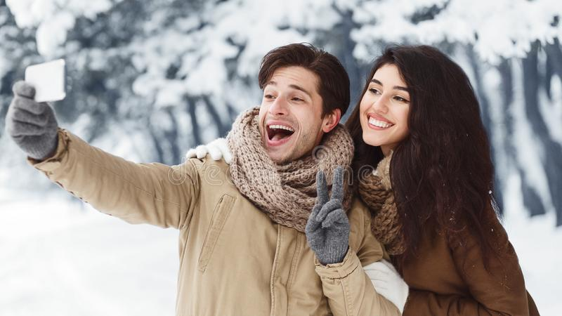 Couple Taking Selfie On Phone Standing In Winter Forest, Panorama royalty free stock photos