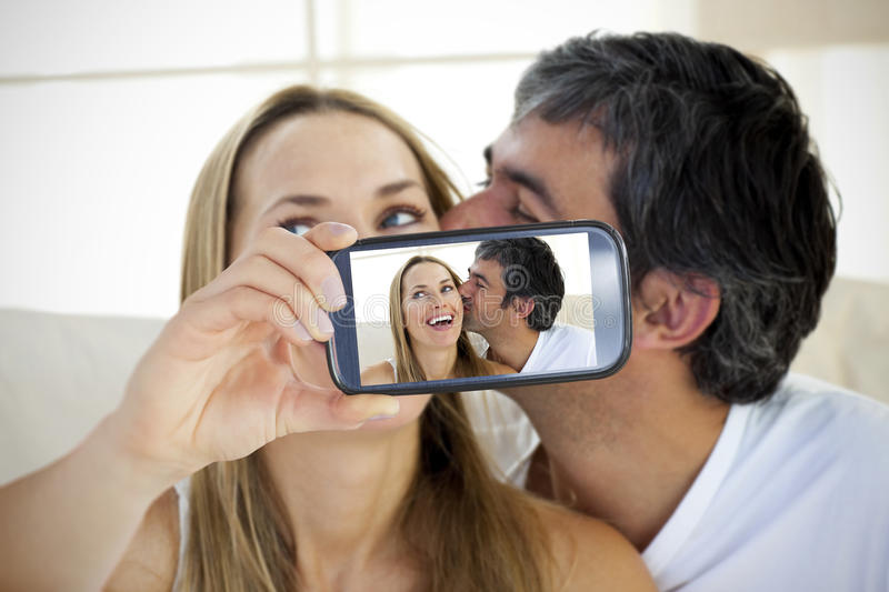Couple taking selfie on smartphone stock images