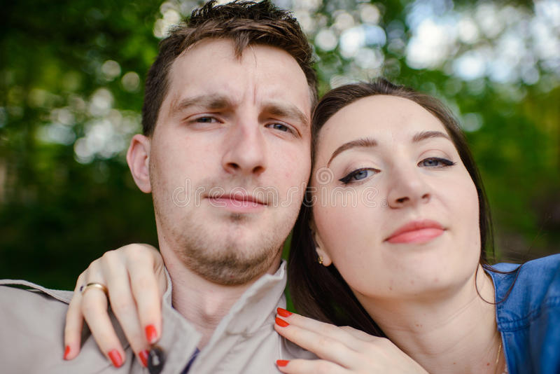 Couple taking a selfie on a summers day. Young couple taking a selfie on a summers day in the park stock photos