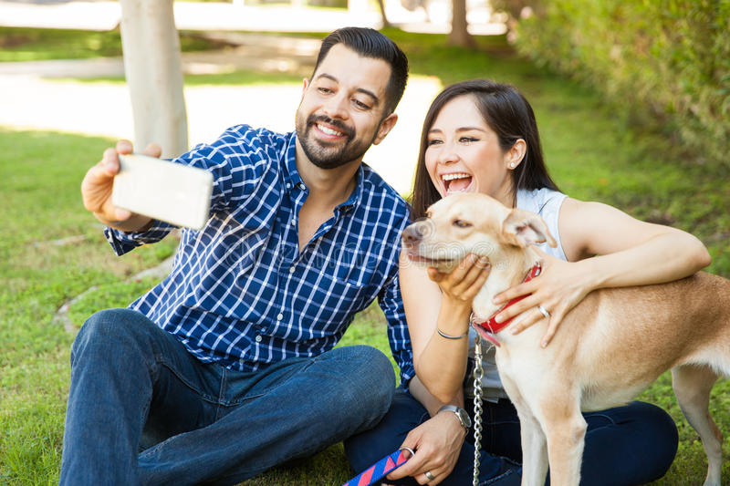 Couple taking selfie with their dog royalty free stock photos
