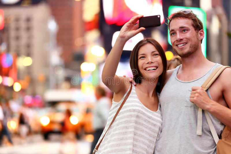 Couple taking smartphone selfie in New York, NYC royalty free stock photos