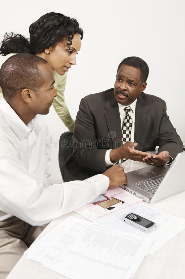 Couple Talking with Accountant stock photography