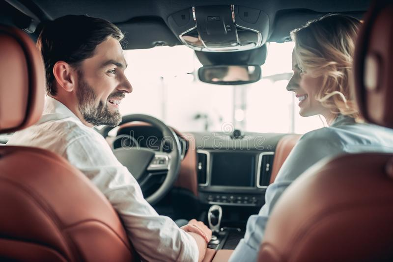Couple talking in new car royalty free stock photography