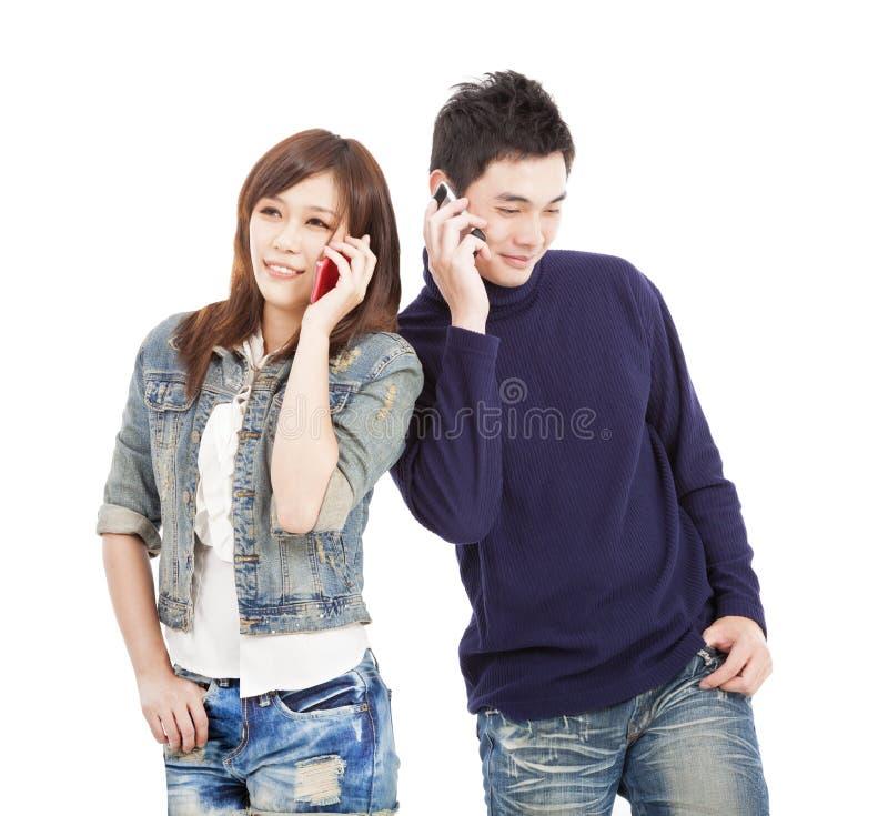 Couple Talking On The Phone Stock Photos